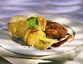 Stuffed ostrich steak with potatoes