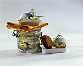 Swedish herring in jar and with pumpernickel rounds