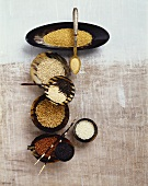 Various types of cereals and rice in small bowls