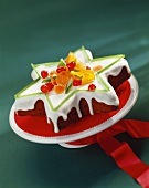 Star-shaped cake with glace icing and candied fruit