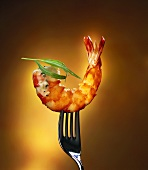 Shrimp tail with herb butter on fork