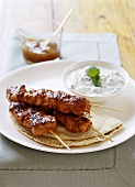 Tandoori chicken kebabs with raita (India)