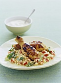 Chicken thighs on couscous
