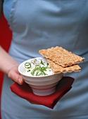 Small bowl of herb quark and crispbread