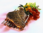 T-bone steak with pepper crust on barbecue rack