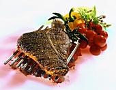 T-bone steak with pepper crust on barbecue rack