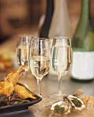 Seafood appetisers with drinks