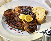 Barbecued T-bone steak with pepper crust