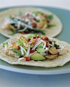 Wheat tortilla with chicken and avocado