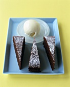 Chocolate cake with scoop of ice cream on tray