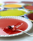 Colourful fruit jellies on plates