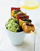Salmon and vegetable kebab on guacamole