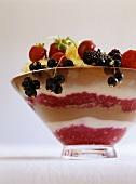 Layered dessert with fresh berries and ice cream