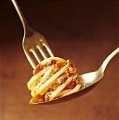 Spaghetti bolognese on fork