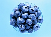 Blueberries with drops of water in a bowl