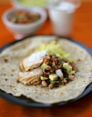 Wheat tortilla with chicken breast and vegetables