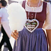 Woman with candyfloss & gingerbread heart at October Fest