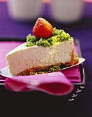 A piece of New York cheesecake with strawberry and basil sugar