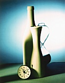 Still life with alarm clock, vase, bottle and hourglass