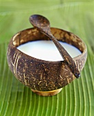 Coconut milk soup in a wooden bowl