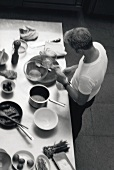 Young man preparing kitchen utensils and ingredients