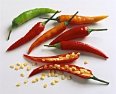 Chili peppers, whole and halved