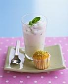 A glass of mint yoghurt with a pistachio bun