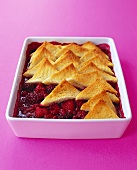 Berry compote with toast triangles in a baking dish