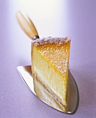 A piece of cheesecake on purple background