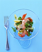 Shrimp and vegetable salad in a glass bowl