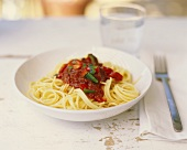 Spaghetti with tomato sauce and a glass of water