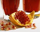 A piece of pomegranate, pomegranate seeds & pomegranate salad
