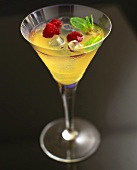 Champagne cocktail with raspberries