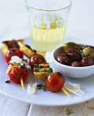 Tomato and bread kebabs and olives