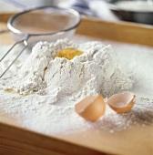 Egg broken into flour