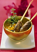 Two venison rissole kebabs in pineapple chutney