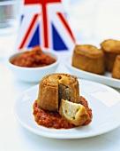 Pork pie on tomato relish, England
