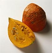 Two pumpkin wedges (variety: Hokkaido)