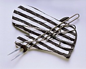 Barbecue tools with striped barbecue glove