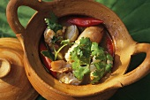 Seafood soup in terracotta pot (Thailand)