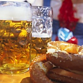 Tankards and pretzels on table (October Fest, Munich)