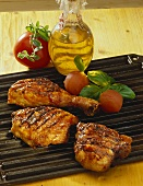 Barbecued chicken and meat, tomatoes, olive oil, herbs
