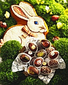 Chocolate eggs in basket in front of Easter Bunny
