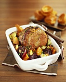 Braised beef with vegetables in roasting dish