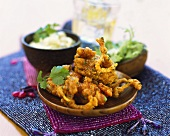 Deep-fried seafood with onions and coriander leaves and rice