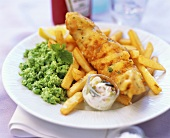 Deep-fried fish fillet with chips and mushy peas