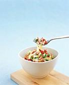 Ribbon pasta with ham, peas and cream sauce