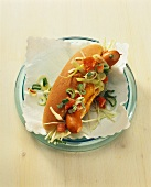 Hot dog, garnished with vegetables