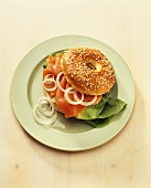 Sesame bagel with smoked salmon and onion rings
