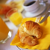 Croissant, coffee and orange juice for breakfast